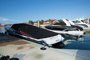 An image of the Formula Boats 382 Bimini Canvas Cover. This illustrates an example of how one can use a canvas when leaving the boat docked.