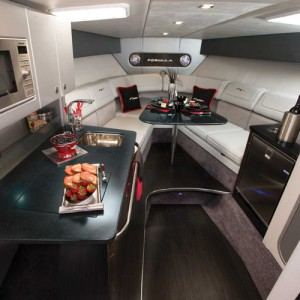 An image of the 350 FX cabin, featuring all kitchen appliances and speakers as well as a seating area. This is to show how much comfort and luxury has come through the years.