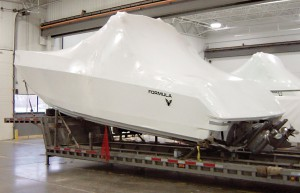 A shrink-wrapped boat in storage. This image is to complement what is written in the paragraph about cutting through shrink wrap to check for any signs of damage.