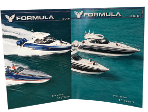 An example of what a vintage brochure looks like. Image displays a glossy, magazine opened displaying two older boat models cruising across the sea.