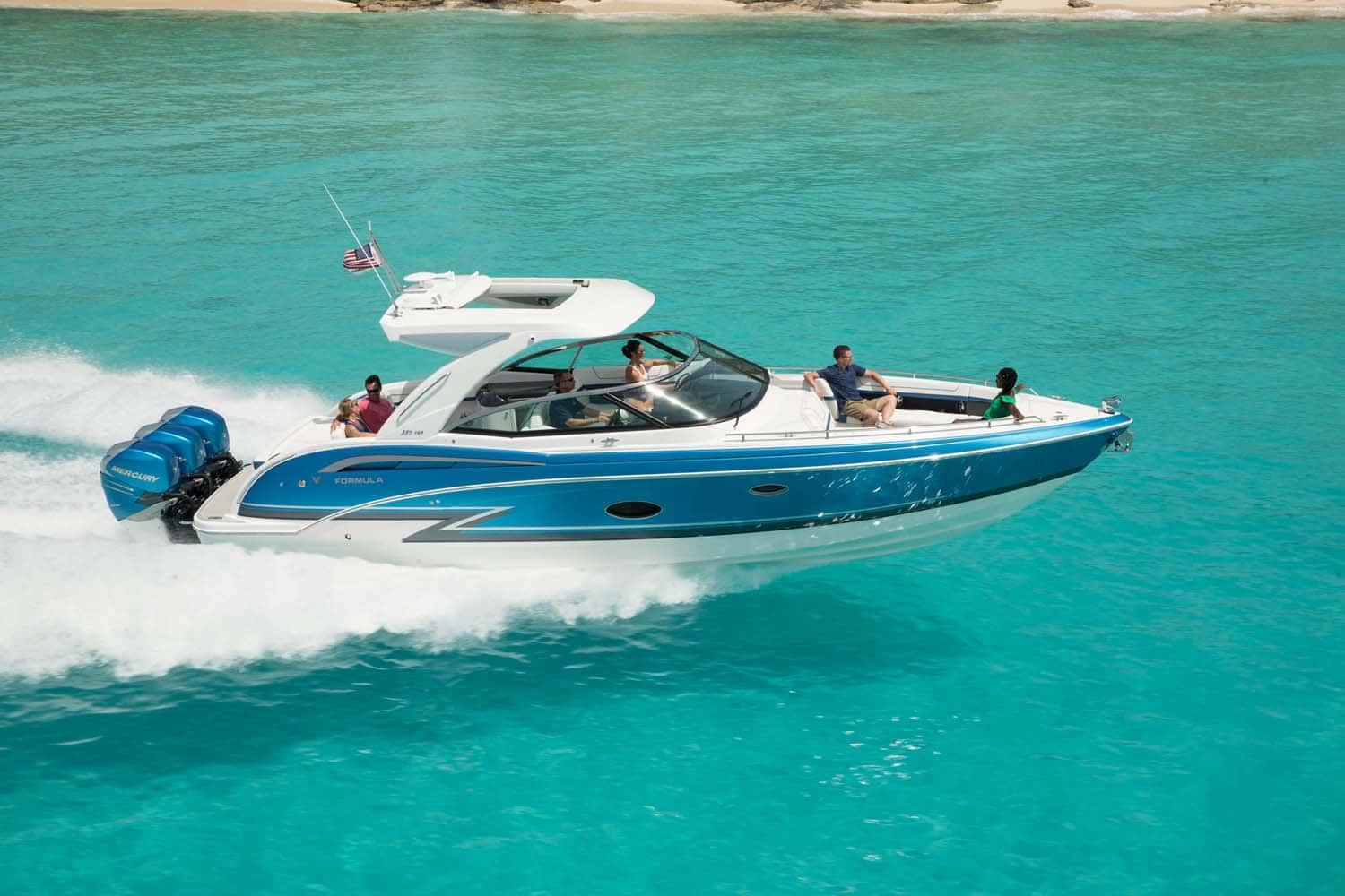 An image of the 350 Crossover Bowrider boat (known as the 350 CBR) on the ocean for better understanding of the model visually. Shows a white boat with teal markings and three motors. 6 people are on the boat relaxing as it cruises.