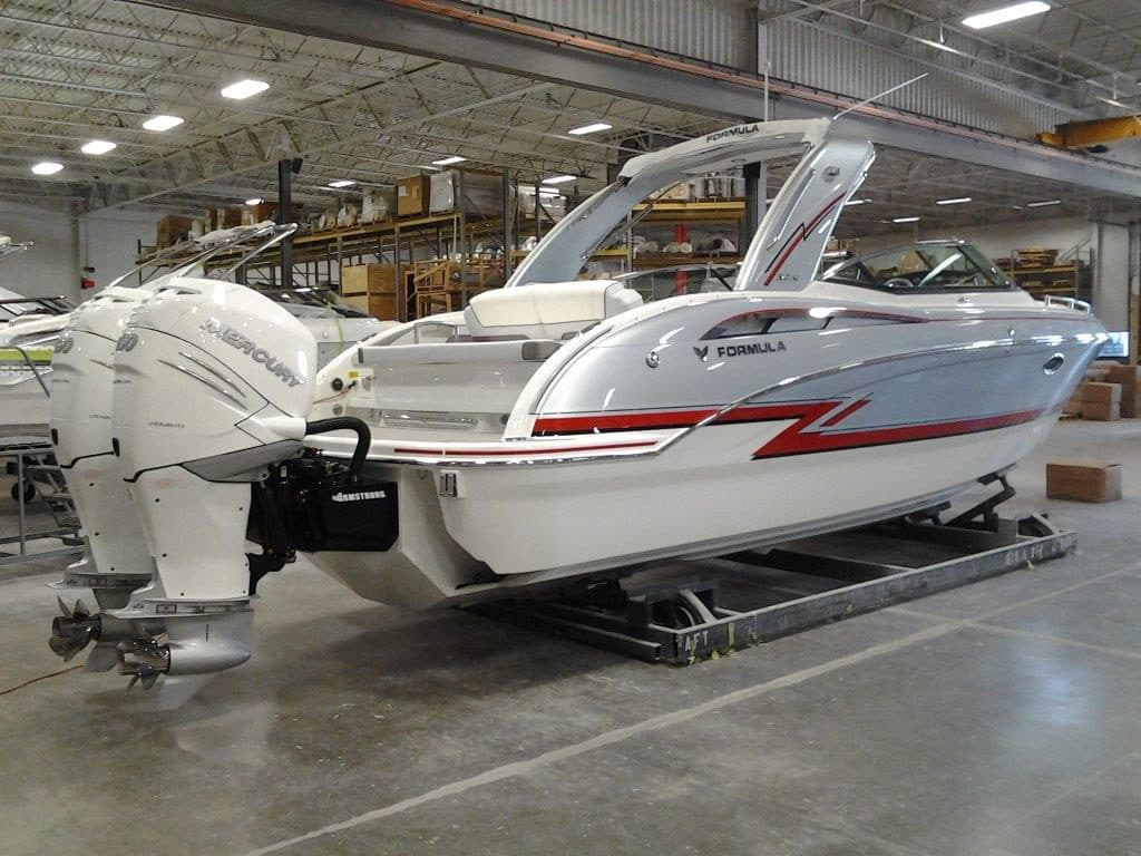 An example of customization that FormulaFlex offers on hull design. The hull has jagged red stripes on a light blue/silver background.